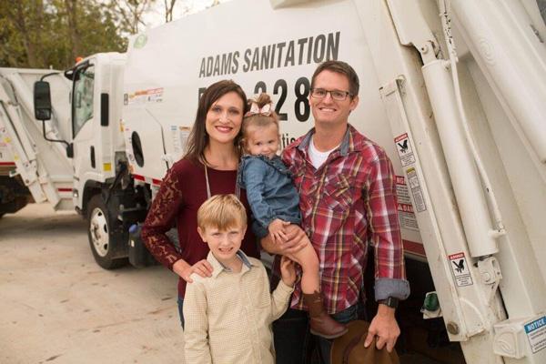 Adams Sanitation trash hauler and family